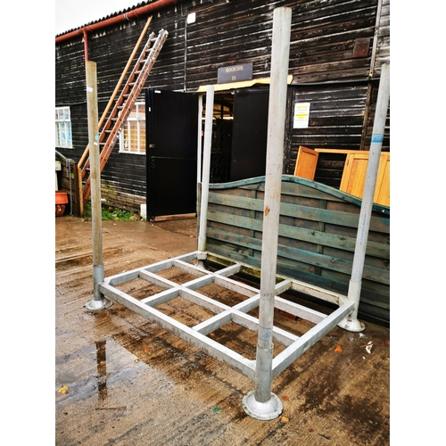 21 - Metal pallet with corner posts approx 5' x 4'...