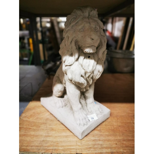 32 - Concrete sitting lion garden ornament approx 15'' tall...