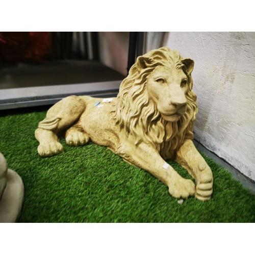 34 - Concrete garden ornament lying down lion...