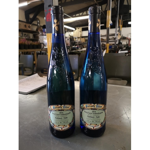 491 - Two Pieroth Blue wine bottles including contents....