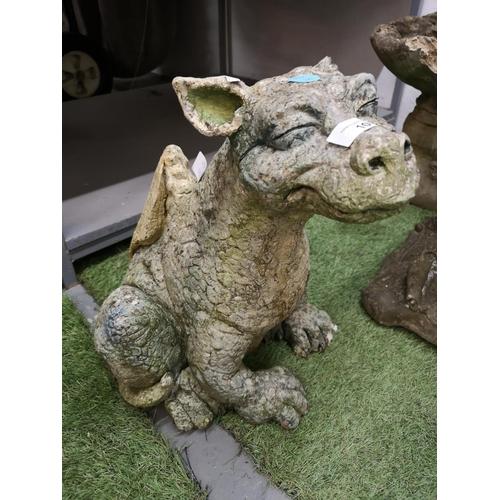10 - Large sitting concrete dragon...