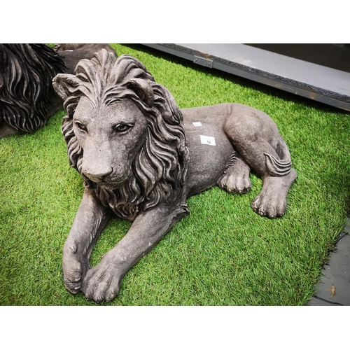 18 - Large reclining lion left handed...