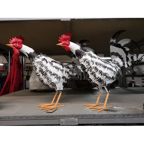 21 - Two large metal chickens...