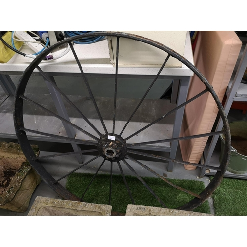 31 - Large metal wagon wheel...