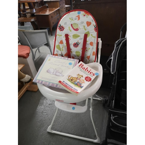 401 - Baby highchair by kiddie care and baby books...