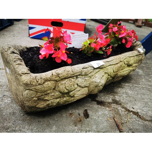 23 - Garden contrete planter with begonia plants....