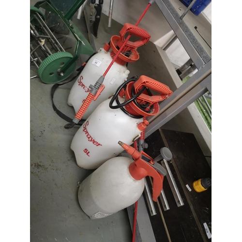 64 - Three garden pressure sprayers...