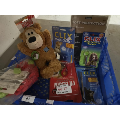 63 - Tray with dog toys, dog clicker and training aids...