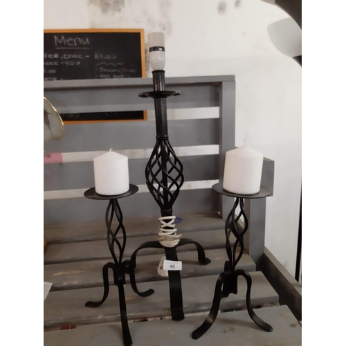 48 - Black twisted metal lamp and two candle sticks...