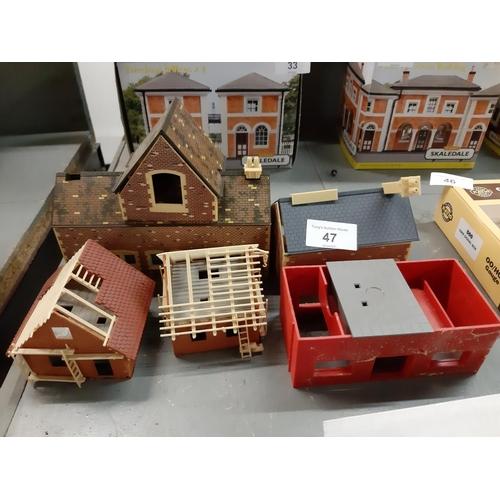 47 - Six Plastic buildings