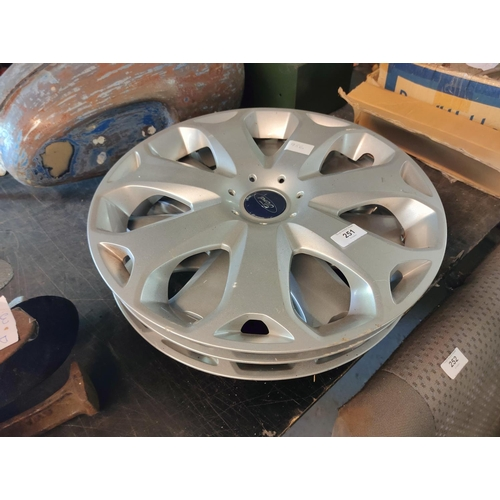 251 - three 17 inch ford wheel trims in good condition