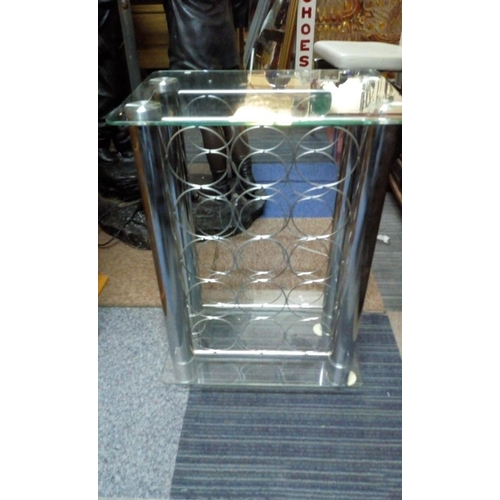 421 - Stainless steel wine rack measures 30cms X 42cms X 63cms tall holds 15 bottles...