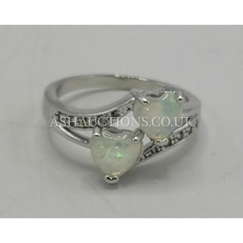 55A - PRESENTED AS A SILVER (925) FIRE OPAL STONE SET RING (Size Q)...