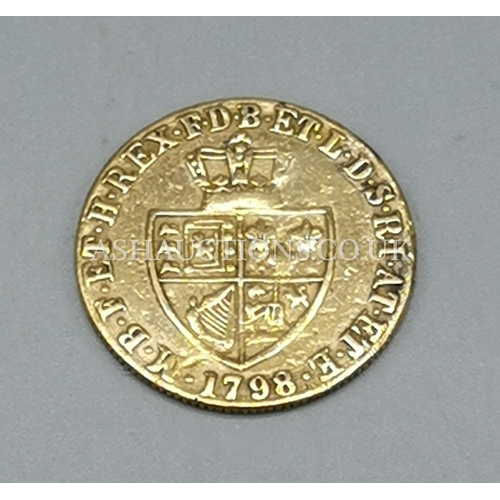 301 - PRESENTED AS A 1798 HALF GUINEA 22ct COIN...