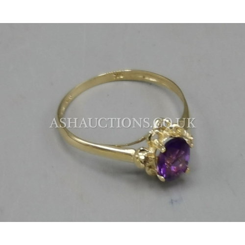 25 - PRESENTED AS A 9ct GOLD AMETHYST & DIAMOND STONE SET RING...