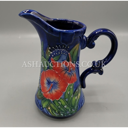 60A - OLD TUPTON WARE TUBELINED 15cm JUG (1586) IN THE HIBISCUS DESIGN ON BLUE GROUND...