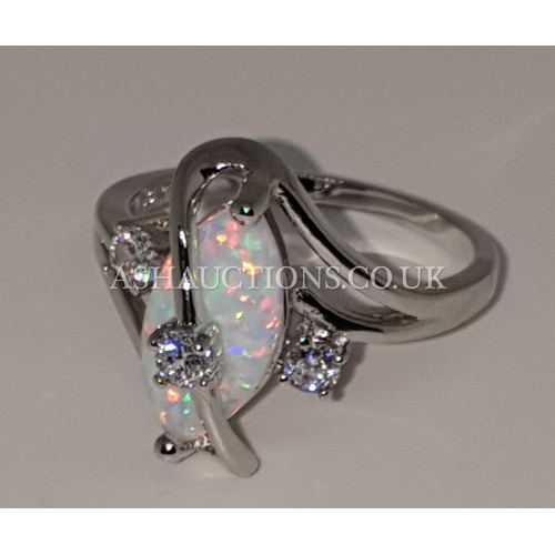 70A - PRESENTED AS A 10kt WHITE GOLD FIRE OPAL STONE SET RING (Size S)...
