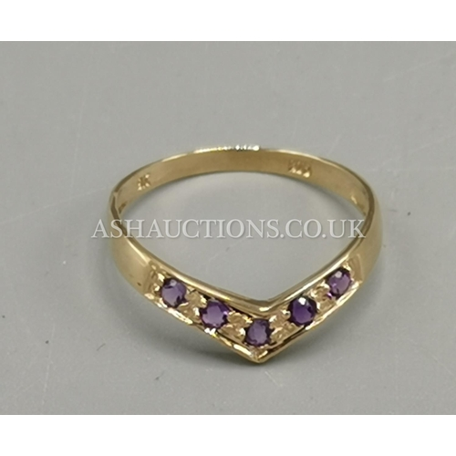 86 - PRESENTED AS A 9ct GOLD AMETHYST STONE SET WISHBONE RING...