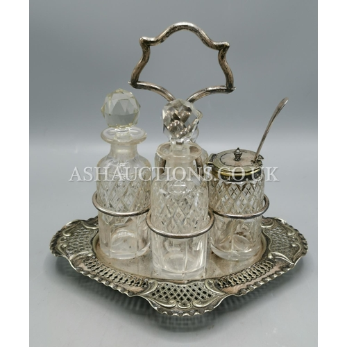 19 - VICTORIAN GLASS CRUET SET IN STAND...