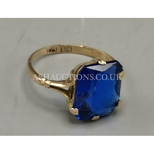 7 - PRESENTED AS A 9ct ROSE GOLD BLUE STONE SET RING (Weight 2.53 Grams)...