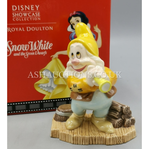 23 - ROYAL DOULTON DISNEY CHARACTER DWARF FIGURINE OF HAPPY