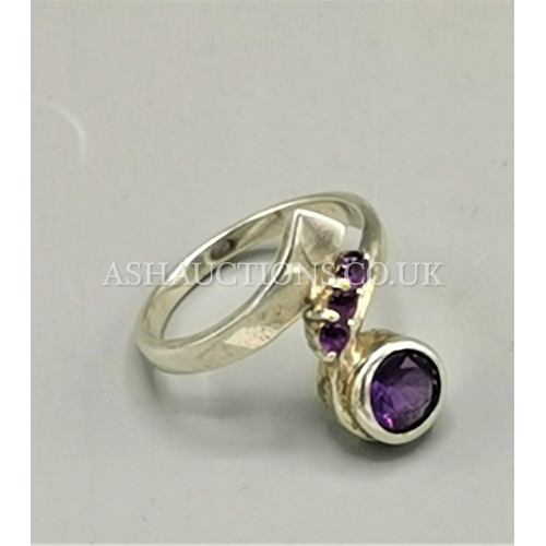18 - PRESENTED AS A SOLID SILVER (925) AMETHYST STONE SET RING....