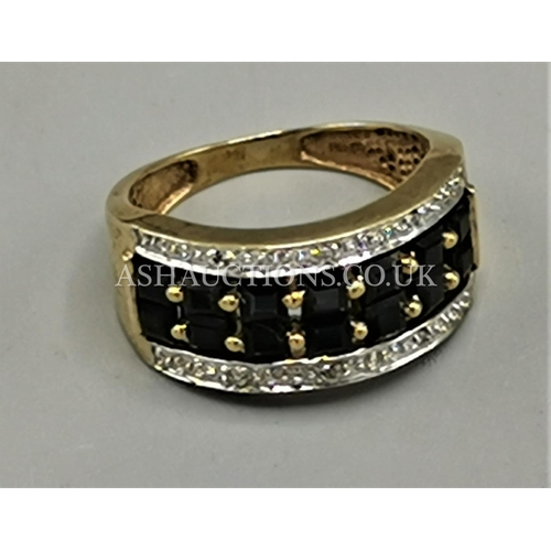 31 - PRESENTED AS A 9ct GOLD BLACK & SILVER RING...