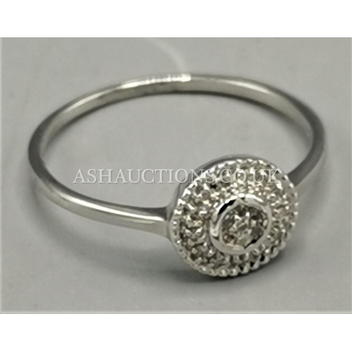 40 - PRESENTED AS A WHITE GOLD LADIES RING....