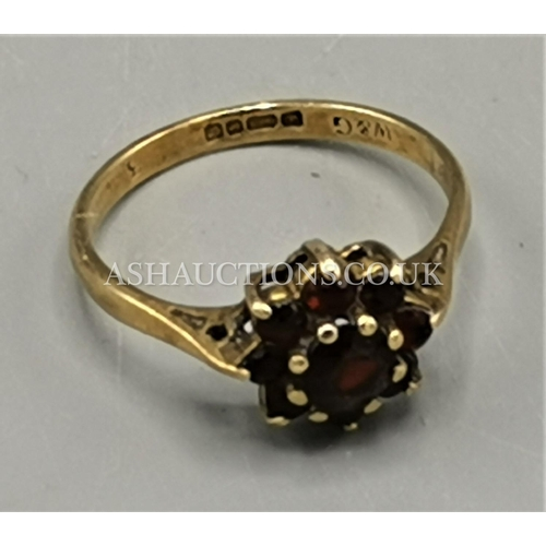 42 - PRESENTED AS A 9ct GOLD RED GEM STONE RING....
