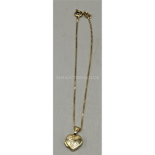 115 - PRESENTED AS A 9ct GOLD (375) HEART PENDANT ON CHAIN...
