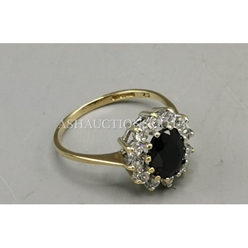 62 - PRESENTED AS A 9ct GOLD SAPPHIRE STONE SET LADIES RING...