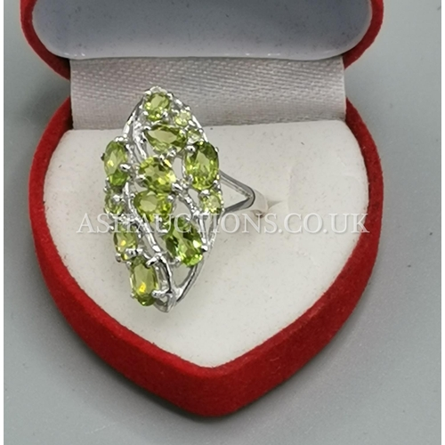 7 - PRESENTED AS A SILVER (925) SILVER / PERIDOT STONE SET RING (Boxed)...