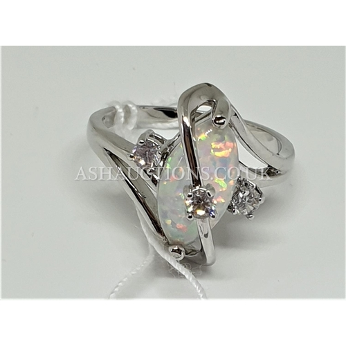 85A - PRESENTED AS A 10kt WHITE GOLD FILLED STONE SET RING...