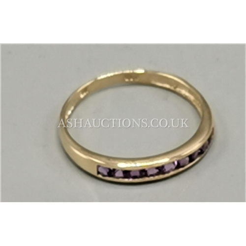 86 - PRESENTED AS A 9ct GOLD FIVE NATURAL AMETHYST STONED RING...