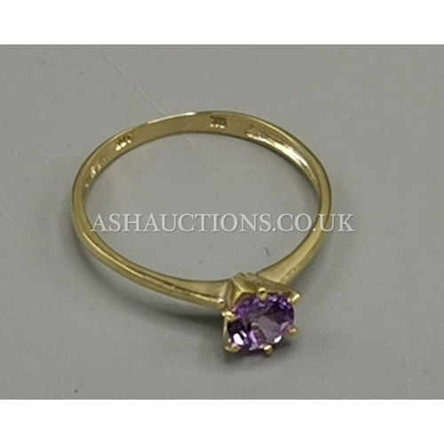 88 - PRESENTED AS A 9ct GOLD AMETHYST SOLITAIRE RING...