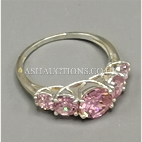 23 - PRESENTED AS A SILVER (925) PINK STONE SET RING...