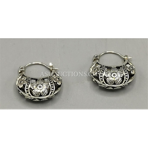 60I - PRESENTED AS A PAIR Of ORNATE SILVER EARRINGS...