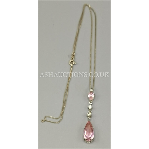36 - PRESENTED AS A SILVER LADIES CHAIN WITH PINK PENDANT...