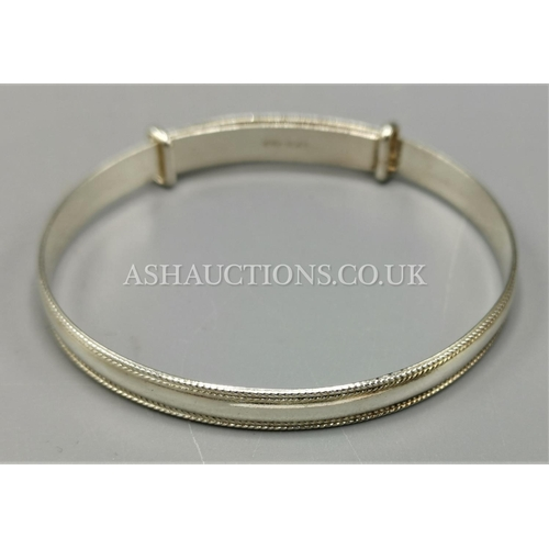 38 - PRESENTED AS A SILVER MARKED BABIES BANGLE...