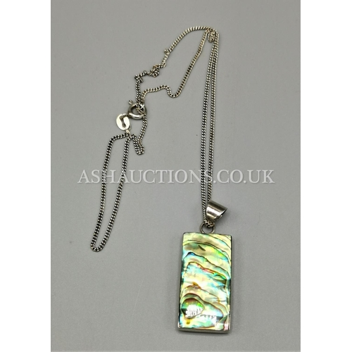 39 - PRESENTED AS A SILVER (925) MOTHER OF PEARL PENDANT ON CHAIN...