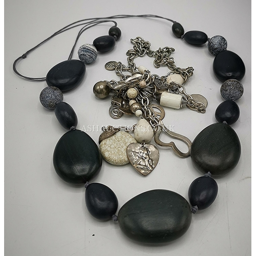 12 - CONTEMPORARY AUSTRALIAN NECKLACES (2) 1 DARK GREY MADE OF WOOD ? THE 2nd MADE OF STONE & WHITE METAL...