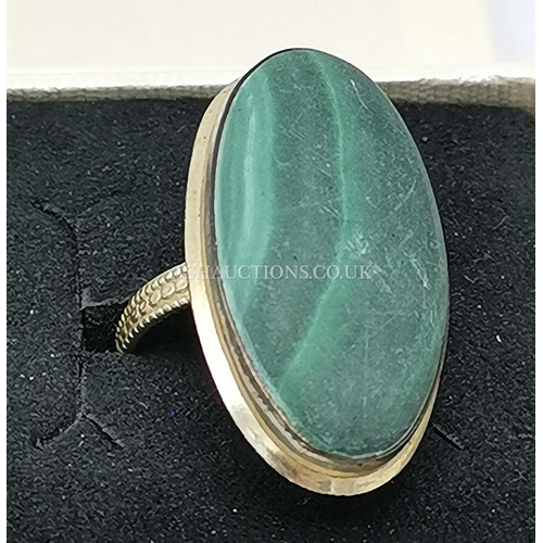 60 - PRESENTED AS A STERLING SILVER & MALACHITE RING (Size Q)...