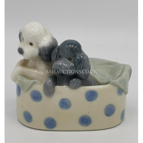 44 - LLADRO (Nao) MODEL OF TWO PUPPIES IN A BASKET...