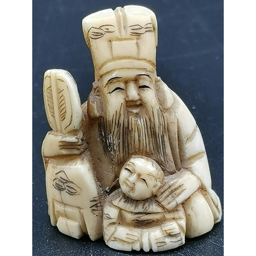 10 - JAPANESE NETSUKE DEPICTING A PRIEST WITH BOY...
