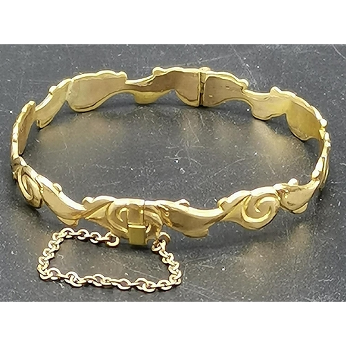 30 - PRESENTED AS A ROLLED GOLD DOLPHIN BANGLE...