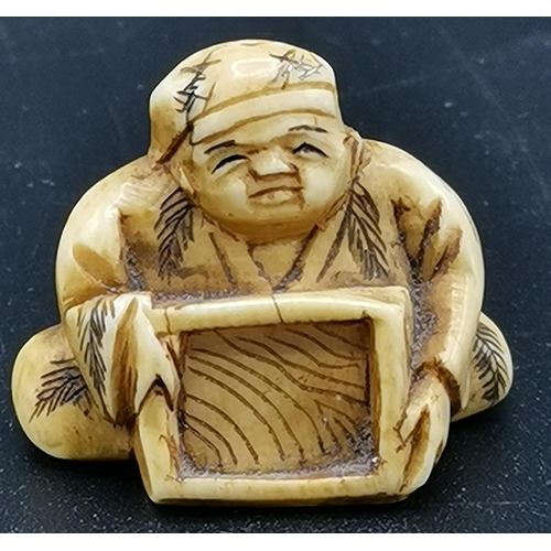 9 - JAPANESE NETSUKE DEPICTING A SCHOLAR HOLDING WRITING BOARD...