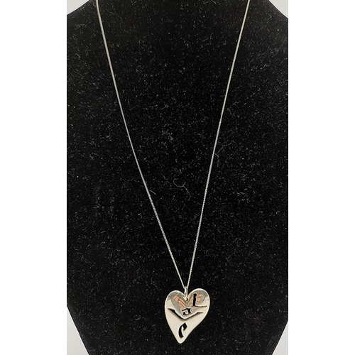 11 - PRESENTED AS A SILVER (925) JAPANESE LOVE HEART PENDANT ON A 42cm NECK CHAIN...