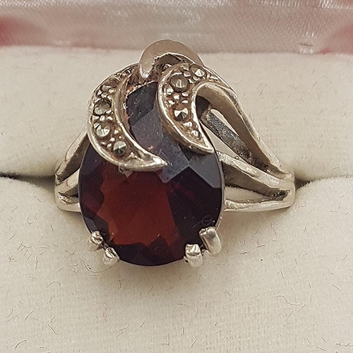 732 - PRESENTED AS A SILVER/GARNET (Stamped 925) And MARCASITE ART DECO COCKTAIL RING (Size R, Weight 8.4 ...