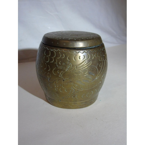 36 - An antique & engraved bronze pot with cover...
