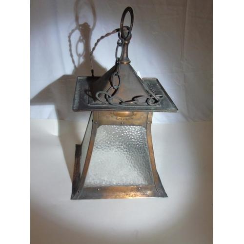 37 - An arts & crafts copper hanging lantern...